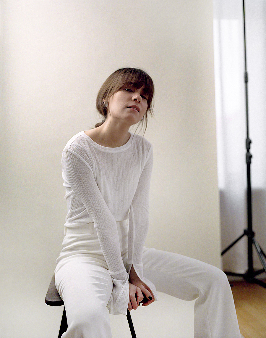 Outfit: All White. Nisi is wearing: White longsleeve. White trousers, Jil Sander, Earrings