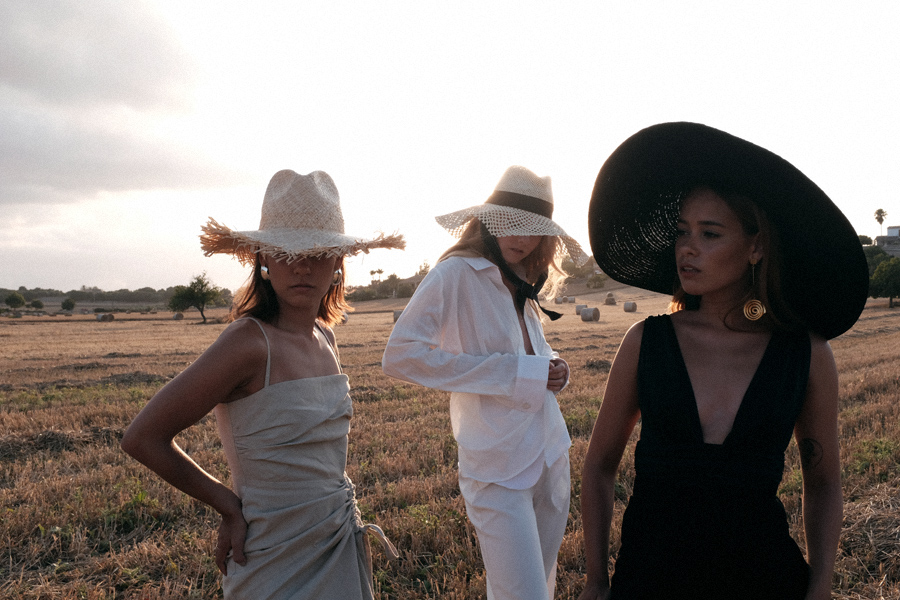 Monochrome looks on the fields of Majorca: white Jacquemus blouse, white palazzo trousers, ruffled linen dress, black bathing suit, white cropped pants, Jacquemus earrings, All Blues earrings, Brie Leon hoops, straw hats