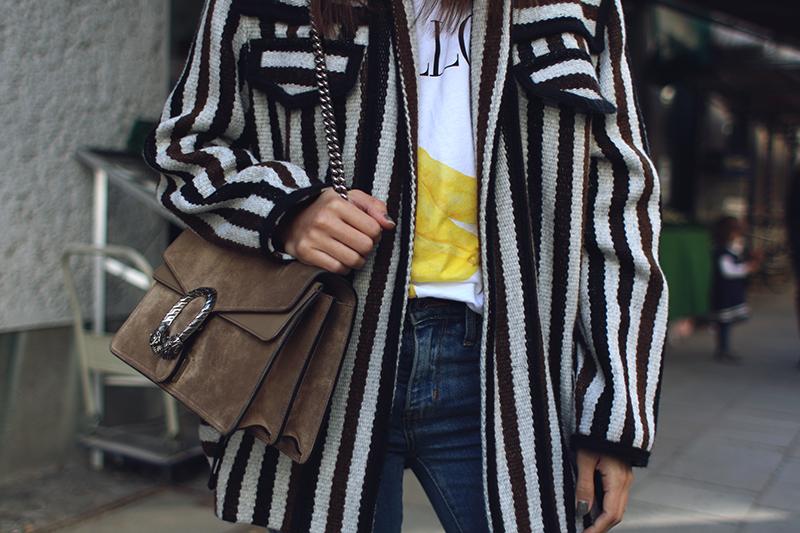 Nisi is wearing: Isabel Marant Étoile Breeda coat, Ganni murphy t-shirt, Levi's skinny jeans, Gucci Dionysus bag, Acne Studios jensen boots