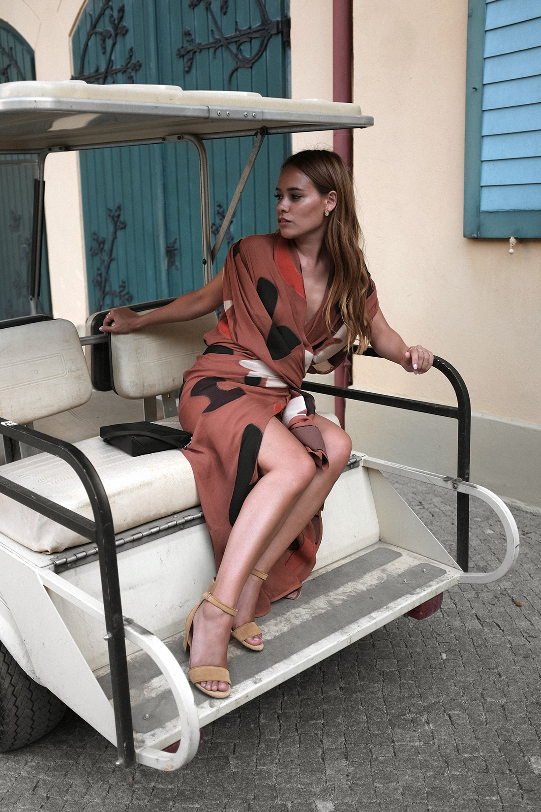 Jacquemus La Robe Henri asymmetric twisted dress, Loewe Puzzle bag suede, Tabitha Simmons Leticia 75 sandals, L'Or Liquide earrings by teetharejade